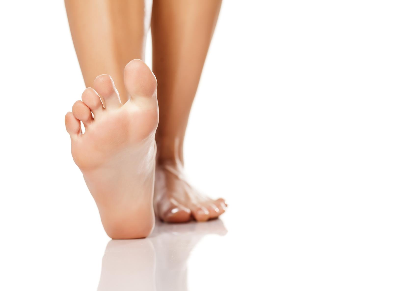 nicely nursed women's feet on white background